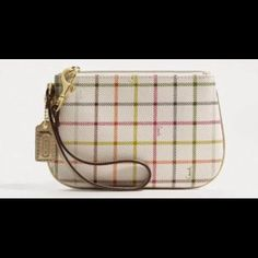 "1 DAY SALE!! NWT Coach wristlet 1 DAY SALE!! NWT Coach multicolored with gold trim wristlet.  Includes original coach box!!  Measures approx 6 1/2"" in length & 4 1/2"" in height Coach Bags"