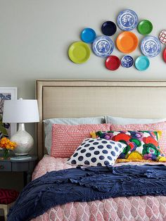 This is a really beautiful way of introducing colour into the bedroom. The plates snd decorator pillows Are the heroes of the room. The studded linen headboard and mother of pearl lamp help balance the room. From: Do it.
