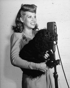 Dinah Shore and her dog take part in a radio show, 1942