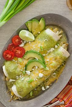 """AVOCADO CREAM ENCHILADAS SUIZAS ~~~ the orig enchiladas suizas were chicken in tomatillo cream sauce. one now sees occasional ingredient twists. the name, """"swiss enchiladas"""" alludes to its copious use of dairy. recipe gateway: this pin AND from the book, """"fiesta at rick's"""" at http://www.seriouseats.com/recipes/2010/12/enchiladas-suizas-rick-bayless-recipe.html AND four 5star recipes, incl the original, at http://www.pinterest.com/pin/239816748882596962/ [foodiecrush] [Mexico, Mexico City]"""