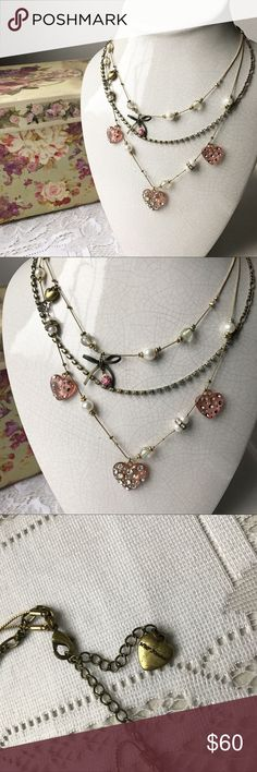 Betsey Johnson Heart & Bow Necklace Beautiful multi-strand necklace by Betsey Johnson in outstanding condition 💖 Gold tone with pink hearts Betsey Johnson Jewelry Necklaces