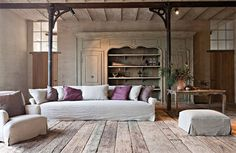 Summer: Slipcover velvet furniture, replace orientals with sisal rugs.