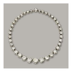 DIAMOND RIVIÈRE NECKLACE- Composed of thirty-eight graduated circular-cut diamonds together weighing approximately 93.00 carats