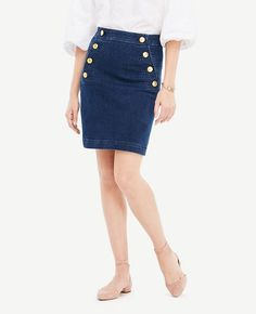 "Refined style is smooth sailing in this flattering denim skirt, topped with button front pockets for a nautical nod. Button front pocket plackets. Hidden back zipper with hook-and-eye closure. 21"" long."