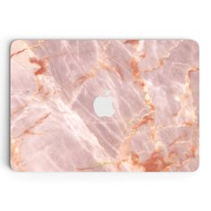 """- Description - Features The Blush Marble MacBook skin is a definite heartthrob. Show your MacBook some love with a premium MacBook Skin from UNIQFIND – It's sure to make you blush. *13"""" and 15"""" MacBo"""