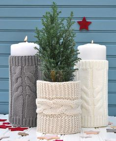 Christmas Candles Covered With Sweater Sleeves