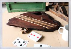 A cribbage board made by the actual Ron Swanson (ok, it's made by the actor who plays him). I would so buy this for my brother if it didn't cost so much.