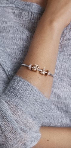 Adorn your wrist with two-tone stunners in PANDORA Rose and sterling silver. Perfect for spicing up a wintery sweater look!