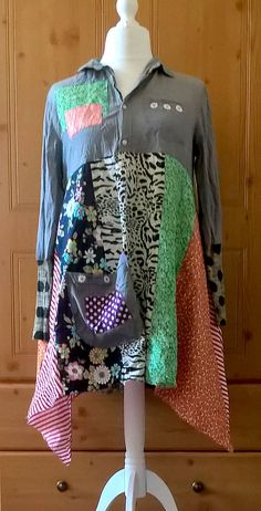 A fabulous and fun unique dress for work or play. Mismatching light cottons float out from a grey cotton/linen shirt top. Funky altered sleeves and big pocket. Measurements: Bust 38 - 44 ins Length 39 - 46 ins. Please CHECK your measurements carefully. Returns Policy: I do accept returns and exchanges if you are not completely happy with your item. Please notify me within 7 days of receiving your item if you intend to return it. Must be mailed back within 14 days and in original condi...