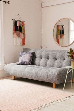 Urban Outfitters Winslow Armless Sleeper Sofa click to get more information or how to purchase.