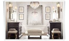 A more traditional bath, but luxurious nonetheless. The two vanities mirror each other instead of being next to one another with the stand alone tub in the middle and pushed back to the far end with a great mirror hanging behind it. Not to mention the fabulous chandelier and sconces.