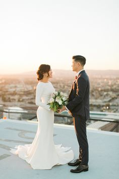 Set at the AT&T Center in downtown L. this rooftop wedding includes panoramic city views and a first look on a hellipad. Plain Wedding Dress, Colored Wedding Gowns, Long Sleeve Wedding, Modest Wedding Dresses, Elegant Wedding Dress, Rooftop Wedding, Courthouse Wedding, Wedding Portraits, Marie