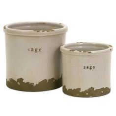 Set of two clay pots with typographic details and a white crackle glaze.   Product: Small and large potConstruction Materi...