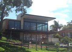 This house by Clayton Orszacky uses the La Paloma Austral bricks and I think Blackbutt cladding