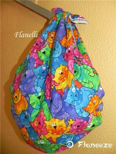 Furoshiki wrapping http://www.modes4u.com/en/kawaii/p9902_colored-designer-fabric-with-funny-colourful-cats.html