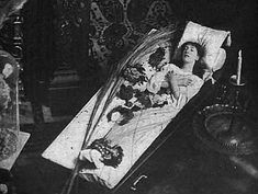 Sarah Bernhardt sleeping in her coffin.
