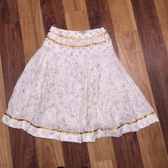Flower patterned skirt Flower patterned skirt. Like new. Size M. 27 inches from top to bottom. Colors are olive green, cream like off white color and golden copper color. Pics provided. Super cute. Feels like a cotton and a gauze like fabric inside skirt. No fabric content label. High quality feel. ❤️❤️❤️ Magic Skirts