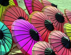 These seem more like parasols...but whatever. I like them because it looks like they're all wearing  yamakas. Yay Jewish umbrellas!