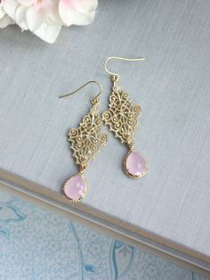 ♥´¨) ¸.•´ ¸.•*´¨) (¸.•´ ♥ ~ Gorgeous matte textured gold plated victorian vintage inspired filigree earrings. A pink opal glass pear framed glass pendant dangles beneath. They hang on gold plated over brass french ear wires. Glass pendants measures approx. 12mm x 18mm. Total length of earrings is approximately 2 3/4 inches long. :: For beautiful and romantic hair accessories : https://www.etsy.com/shop/Marolsha?ref=hdr_shop_menu§ion_id=6291780  :: Thank you for stopping by. Kindly contact me…