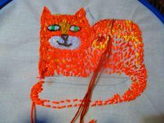 https://flic.kr/p/PA87vX   Hand stitching an orange pussy cat by Sharron Wilcock