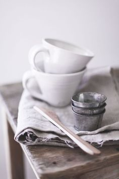 Love the mixture of white crockery with metal and wood kitchen pieces!