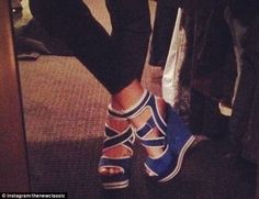 New kicks: The 24-year-old shared a snap of her newly designed mules with platform heel, t...