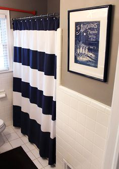 blue nautical shower curtain west elm, add bright colored towels (pink/orange/lime green) for kids bathroom
