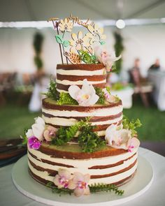 Now that's what we call a tropical treat! Island blooms and a festive topper reflected the theme of this island wedding, as did the flavor: passionfruit-soaked white cake with buttercream frosting from Celebrations by Bev Gannon.