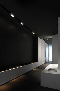 Black and white contrasts inside the Kreon showroom in Paris designed and built by Belgian company Minus.