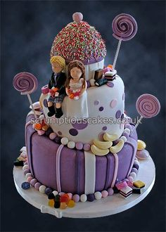 Wedding Cake (849) - 3 tier wonky wedding cake with giant cupcake top tier, bridal couple and sweets.