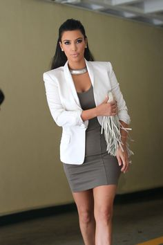 Love that charcoal colour fitted dress and the white jacket adds a bit of elegance.