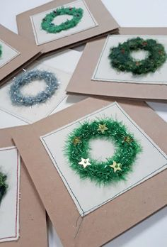 Stitched Wreath Christmas Cards I have been experimenting with looping to make some stitched wreath Christmas cards. Christmas Wreaths, Christmas Cards, Mini Iron, Textured Yarn, French Knots, Running Stitch, Fabric Squares, Your Cards, Weaving