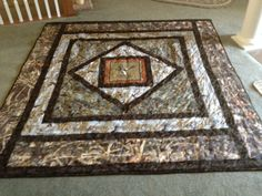 My grandson, Trint's, new camoflage quilt.  He picked out the materials and I put it together.