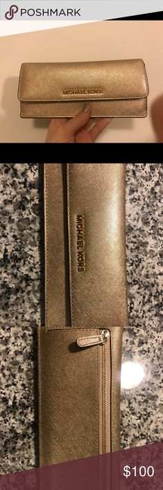 Michael Kors Saffiano Wallet Michael Kors metallic saffiano wallet. Used one time and has been sitting in the back of my closet ever since. Just isn't my style. In great condition! Has a small mark on it that can barely be seen but I posted a picture of it. Michael Kors Bags Wallets