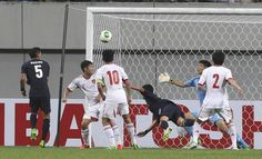 Japan's Yuzo Kurihara , third from right, heads for the ball to score the first goal as China's goalkeeper Zeng Cheng, second from right, fails to save during their Men's East Asian Cup soccer match at Seoul World Cup stadium in Seoul, South Korea, Sunday, July 21, 2013.  www3.daylife.com/photo/0eYgcOv1IM40m