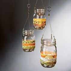 Hanging lanterns made out of old mason jars, wire, and scraps of patterned gift wrap. I loves it. Put a candle in it and bam!