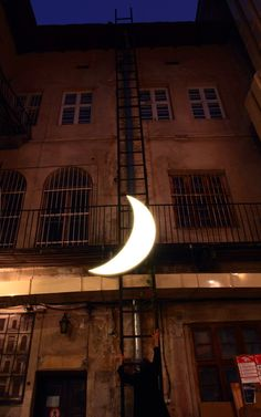 Leonid Tishkov, Russian artist, travels the world with his 'Private Moon.'