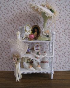 Small Vanity  shelf, Shabby chic white, hand decorated, twelfth scale miniature. $20.50, via Etsy.