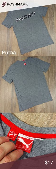 Puma Ducati graphic t-shirt Big boys S Big Boys Small Condition: EXCELLENT. Normal wear. No sign of stains, tears or flaws.  100% cotton Measures 17 inches from pit to pit and is 25 inches long. All measurements taken with garment laying flat. Images represent exactly how product/s look/s like. Ships within 24 hours after purchasing.  BUNDLE AWAY AND SAVE! Puma Shirts & Tops Tees - Short Sleeve