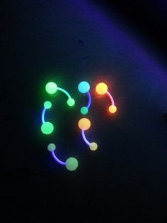 Glow in the dark belly button rings <3