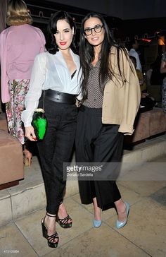 Model/performer Dita Von Teese (L) and actress Demi Moore attend an intimate dinner hosted by Charlotte Olympia Dellal and Liz Goldwyn at The Sunset Tower Hotel on May 12, 2015 in West Hollywood, California.