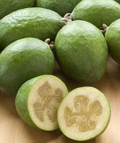 Feijoa - Colombian fruit sometimes referred to as pineapple guava, feijoa is usually blended into a tasty juice. It is also commonly used in skin creams. Exotic Fruit, Tropical Fruits, Fresh Fruits And Vegetables, Organic Vegetables, Fruit Recipes, Wine Recipes, Pineapple Guava, Strange Fruit, Gardens