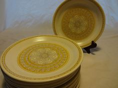 """Very nice vintage Franciscan Hacienda Gold earthenware salad plates. The Hacienda pattern began in 1964. It features a lovely flower, gold band encircling the rim, with a southwestern style band of brown triangles on a speckled white background.  8.25"""" plates"""