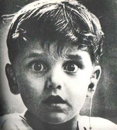 Harold Whittles hears for the first time ever after a doctor places an earpiece in his left ear.