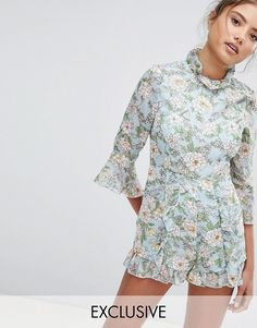 2b3cdea7906 PrettyLittleThing exclusive high neck floral romper at asos.com