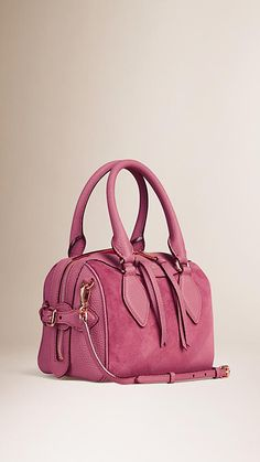 Burberry Mauve Pink The Small Alchester in Check Embossed Suede - A structured bowling bag in check-embossed calf suede and smooth leather.  The bag features a double-layered construction with concealed wing pockets lined in suede, hand-stitched and rolled leather handles and a detachable shoulder strap.  Discover the women's bags collection at Burberry.com