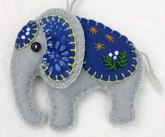 Handmade felt elephant ornament for Christmas or any occasion. Made from grey felt with hand-embroidered details in a range of colours. Please choose red, orange, green, teal, blue or purple from the