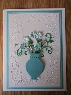 Embossing folder, die cut vase, punched flowers.