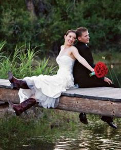 This is such a classy wedding: the brides' dress is beautiful and the red rose bouquet is so sophisticated. The cowboy boots add such a fun personal flair! #westernwedding #countrywedding #cowboyboots