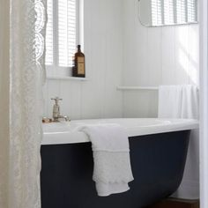 I love the idea of painting the underneath of the tub... with that crisp white shower curtain...